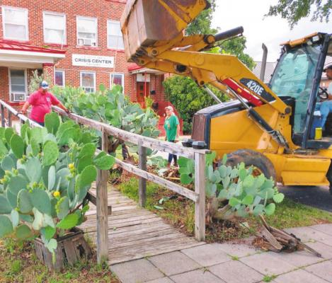 Cactus plants were removed from the front of the Graham Community Crisis Center by members of High Ridge Church recently. Volunteers edged the side walk, trimmed trees and reworked flower beds in front of the building. Contributed photo from Cathy Partridge