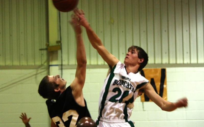 Newcastle High School graduate Brandon Bailey tips off a game in 2011.