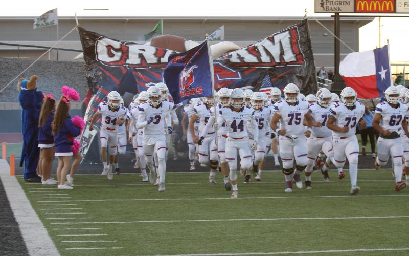 The Graham Steers take the field for the district opener at Iowa Park on Oct. 11. The Steers suffered their first loss to Iowa Park since 2005. Leader photo by Mike Williams