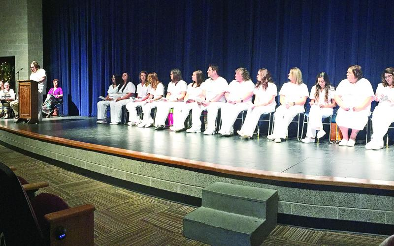 LVN graduates listen as Amanda Sallee, LVN graduate, welcomes friends, family, faculty and staff to the pinning ceremony Aug. 9. (Photos courtesy of NCTC)