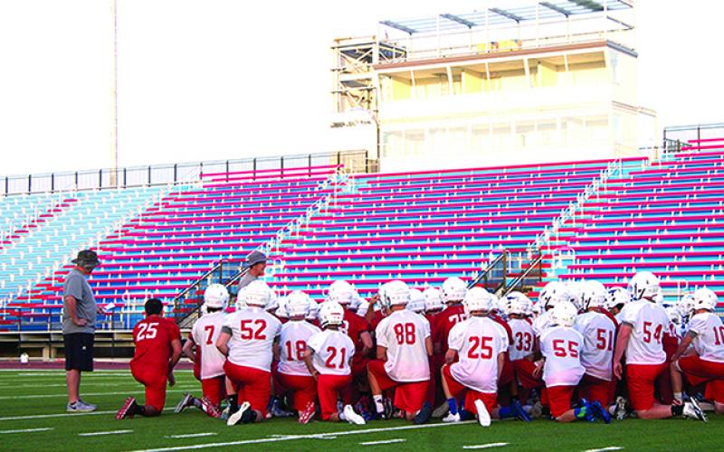 Steers head coach Kenny Davidson addresses his team before practice Monday. With their new stadium and field, the Steers' first official practice of the season featured a lot of energy. Davidson hopes that energy will continue throughout the week.