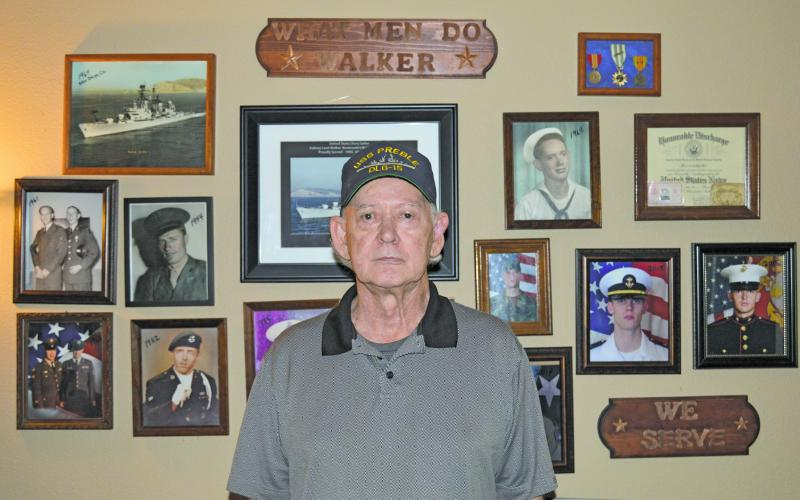 Walker honors family military history with wall display