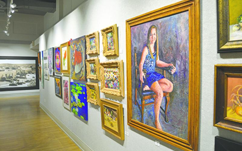While this year's Lake Country Art Show and Sale features many paintings, including those shown above, it also features works in a variety of media.