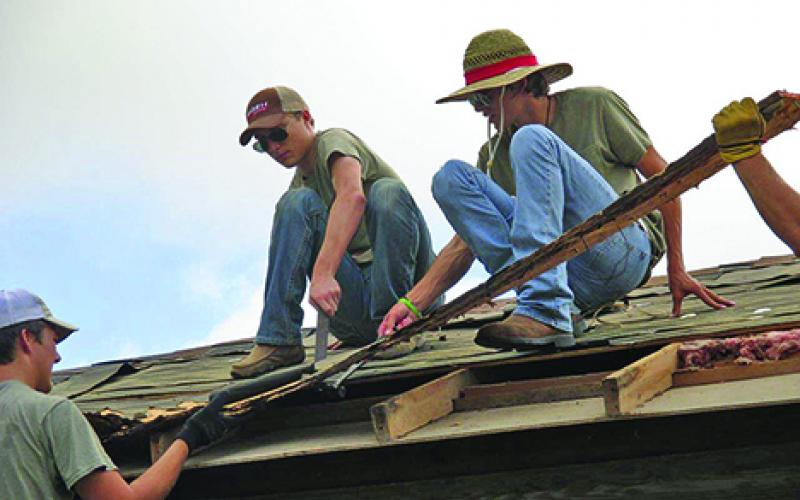 Members of the First United Methodist Church of Newcastle's mission team, l-r, Cody Lowe, Jeb Owens and Shot Lowe, take part in a four-day trip to repair flood-damaged homes in Taylor.