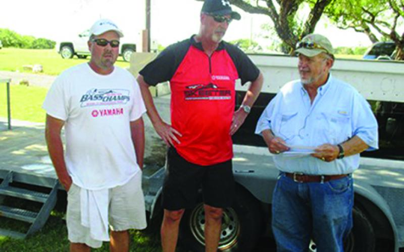 Stefan Dollins and Kelley Hudson are shown here with Hells Gate Bass Club President Bruce Ray after Dollins and Hudson won the club's September two-man tournament.