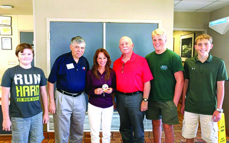 Mitzi Morrison (center) receives the Medal of Freedom Award which is awarded to chapter members who have shown enthusiasm and drive to support the Texas Air Force Associations objectives. Pictured with Morrison from left to right are Brayden Gipson, Dave Dietsch, Mike Winslow, Lats Hansson and Will Busey.