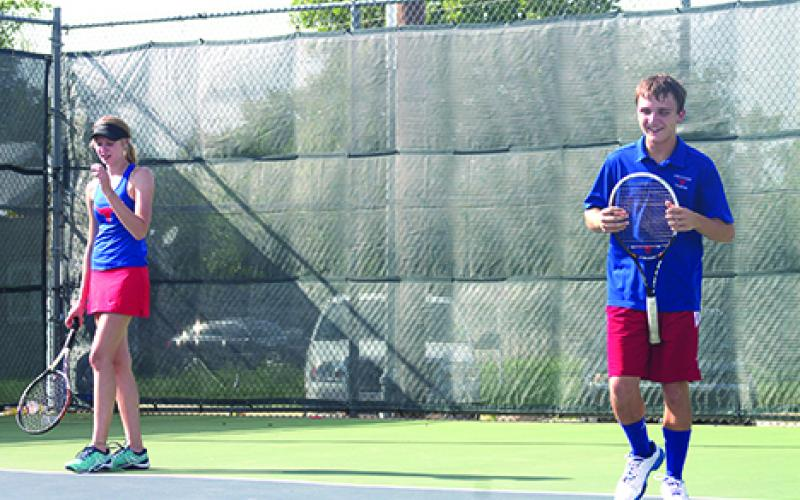 Graham's top mixed doubles team of Sabrina Adrianson and Markus Montfort won their match, though Graham ultimately fell to Iowa Park after rain delays threatened the home-opening tournament.