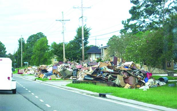 The entire contents of homes, destroyed by August floods in Baton Rouge, La., lined the streets as far as the eye could see when a group from Graham arrived to lend assistance.