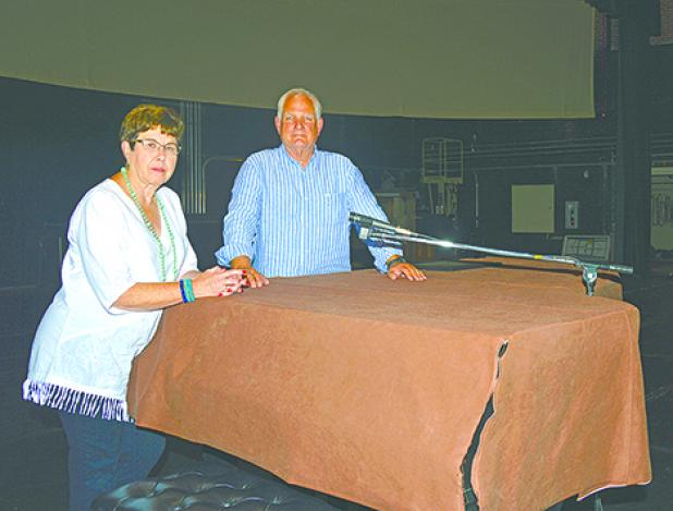 Graham Concert Association member Ellen Morris and President Carter Pettit sit on the stage of the memorial auditorium that was built in 1929 and will host six performances from the association this season. The association is constantly looking for new members to join and help continue the arts in Graham.  (Leader photo by Thomas Wallner)