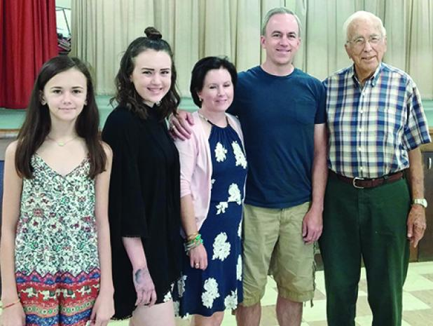Honored for traveling the greatest distance to the 64th annual Rocky Mound Reunion were Michael and Debby Anderson, with their daughters Katie and Claire, who attended from Prosper. With them, far right, is Monroe Robertson, who was honored for being Most Senior Gentleman in attendance.