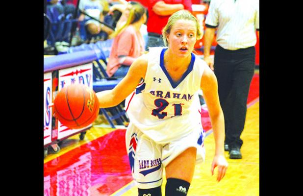 Graham Lady Blues player Ryan Gober looks to drive to the basket during the season opener Saturday afternoon against Jacksboro from Graham High School. The Lady Blues fell to the Tigerettes in the contest.  Leader photo by Evan Grice