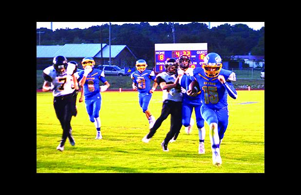 Bryson quarterback Brayden Houser (15) rumbled into the endzone for the game-tying touchdown in the opening quarter. Bryson would go on to out-score Woodson 61-16 in the homecoming event.  Leader photo by Monica Buchanan