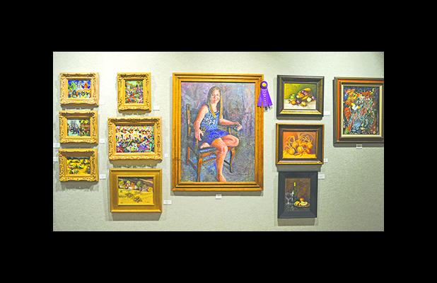 The artwork named Best of Show  in the annual Lake Country Art Show is Sierra, an oil painting by Colleen Erickson, shown at center. (Leader photo by Thomas Wallner)