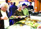 Bethel Baptist Church of Graham, 209 Tennessee St., will host itsfree  Thanksgiving Day dinner from noon to 1:30 p.m. Thursday, Nov. 24. As seen in this photo from a past dinner, volunteers spend part of their holiday serving the traditional fare to their fellow community members.  Contributed photo
