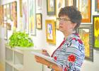 Former Graham ISD Art Director Kathy Lambden judges art entires in the 2016 Lake Country Art Show and Sale. The show brings together 134 pieces of artwork from over 30 artists spread across Breckenridge, Weatherford, Mineral Wells, San Angelo, Granbury and other local West Texas towns.