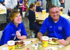 Shawnee Parrish and Kiowa Crow of Graham EMS take a break to eat some barbecue from the Young County Serving Our Servants meal, which welcomed first responders county-wide.