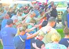 Residents of Graham and visitors from around Young County lift their hands in prayer in support of all first responders who protect the county every day at the Back the Blue Support our Responders event and prayer vigil held Aug. 2 at the Young County Courthouse lawn.
