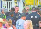 "Graham Police officers, above, including Kyle Ford, facing camera, visit with the public after the prayer service is over and shake hands with those in the audience who thanked them for their service to the city and county, during the ""Back the Blue Support our Responders"" event and prayer vigil, held Aug. 2."