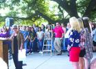 Betty Burgess, regent of the Silas Morton Chapter of the Daughters of the American Revolution, gives recognition to Graham High School Student Council vice president Jessica Burgess (front, right) for her speech at the 79th annual Graham DAR Flag Raising Ceremony. Jessica is Betty Burgess' granddaughter.