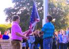 Graham High School Student Council officers Jeff Hazlett (left) and Kolton Gough raise the flag at the 79th annual DAR flag raising ceremony, held Wednesday in front of Graham High School.