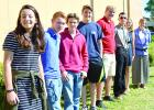 Seven of the 18 Graham ISD students who will attend the 2017 presidential inauguration pose with Graham High School math teacher Chrysti Mercer after speaking to the Graham Kiwanis Club on Thursday, Oct. 20. Shown here are, l-r, Alex Husen, Garrett Box, Rob Lucas, Reagan Menard, Jack Mercer, Kody Morris, Mattie Sullivan and Mercer. Mercer will lead the trip along with her husband, Jeff Mercer. Leader photo by Thomas Wallner
