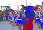 Graham Steer Mascot Old Blue cheers with the Bella Blues and the Graham High School cheerleaders before the homecoming bonfire. Students, teachers, parents and residents came out to the bonfire to celebrate Graham's homecoming.