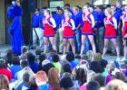 The Graham High School cheerleaders and football team make an appearance at the Crestview Elementary Homecoming pep rally Thursday morning.