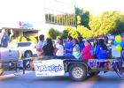 Members of the Graham Kiwanis Builders Club wave to the crowd during the Homecoming parade on Thursday evening.