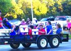 The GHS Torch Club shows spirit during the Homecoming parade Thursday evening.