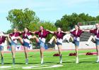 The Bella Blues perform a kick-line at the GHS Homecoming pep rally on Thursday afternoon.