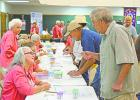 Volunteers from the Graham Regional Medical Center Auxiliary register residents and visitors who signed up for lab work at the the annual Graham Community Health and Wellness Fair. (Leader photos by Thomas Wallner)