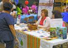 hysical therapist Vickie Keller (left) and office manager Johnnie Mead from Thrive Physical Therapy in Graham talk with visitors at the annual Graham Community Health and Wellness Fair at their booth.