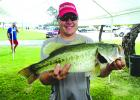 Kris Humpert is shown with his 6.05-pound winner of the Big Bass award during the September Hells Gate Bass Club's 2 Man Tournament. Courtesy photos