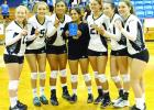 The Graford Lady Rabbits celebrate after winning the Bryson tournament over the weekend. Shown, l-r, are: Rebecca Richardson, Lacie Bell, Esmeralda Balvantin, Betsy Lizalde, Taylor Penn, Sunni Lemley and Rachel Ray. (Courtesy photo)