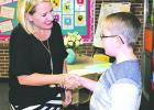 Susan Riley welcomes Aidan Adams to her fifth grade English Language Arts class at Woodland Elementary School during Meet the Teacher events held Thursday afternoon and evening at Graham ISD schools. (Leader photos by Cheryl Adams)