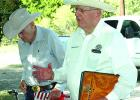 Retired Texas Ranger Ralph Wadsworth, right, speaks to the crowd gathered Oct. 6 to place a Texas Ranger Memorial Cross at the Farmer's Cemetery gravesite of Charles Lemuel Ray. Ray and his brother, Joseph, served in the Rangers' Frontier Battalion from 1874-75.