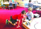 Max Smith (left) and Nate Hutson do a test run of their Lego Mindstorms robot which they constructed for the Texas Computer Education Association State Mindstorms Robotics Challenge. Courtesy photo