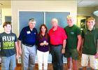 Mitzi Morrison (center) receives the Medal of Freedom Award which is awarded to chapter members who have shown enthusiasm and drive to support the Texas Air Force Associations objectives. Pictured with Morrison from left to right areBrayden Gipson, Dave Dietsch, Mike Winslow, Lats Hansson and Will Busey.
