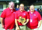 Graham ISD Band Directors (l-r) Hugh Grubbs, Josh Kidd and Dax Freeman pose with the eighth-place trophy that the Rompin' Stompin' Big Blue Band of Graham High School earned following two outstanding performances at the UIL Area B Marching Competition in Denton Saturday. Courtesy photo
