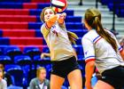 Baylee Loomis finished with four blocks in the Blues' win over Windthorst Tuesday. Loomis, Emily Davis (pictured) and Skylar Morris each had four blocks in the win, and Loomis led the team with four aces.  Leader photo by David Flynn