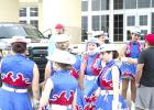 The Bella Blues posed for promotional photos Tuesday morning in front of the Graham High School gymnasium. The drill team sighting is yet another reminder that the excitement and pageantry of Friday night football is close at hand.
