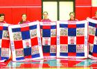 Tuesday night following the Graham High School varsity volleyball game, the five seniors on this seasons squad were presented with throw quilts. The quilts were made by Brenda Rinker, grandmother of senior Lady Blue Delaney Sullivent. Shown, l-r, are Lady Blues seniors Marleigh Sanders, Baylee Loomis, Emily Davis, Delaney Sullivent and Skylar Morris. Leader photo by Evan Grice